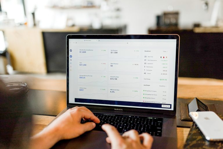E-commerce Person working on laptop inside the Shopify admin